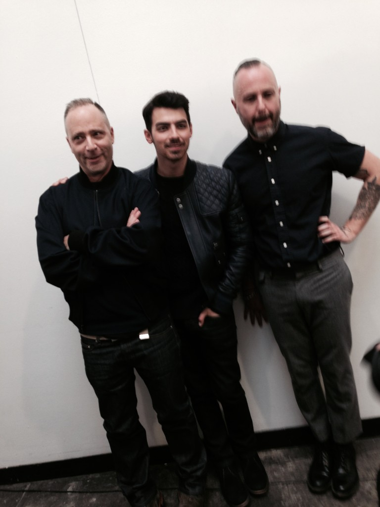 The designers backstage with Joe Jonas