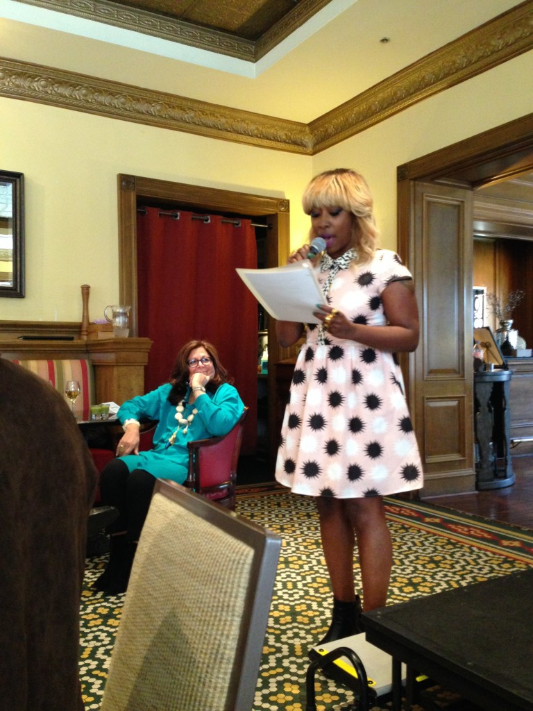 Fern being introduce by Charleston Magazine's Style Director Ayoka Lucas at the FGI luncheon