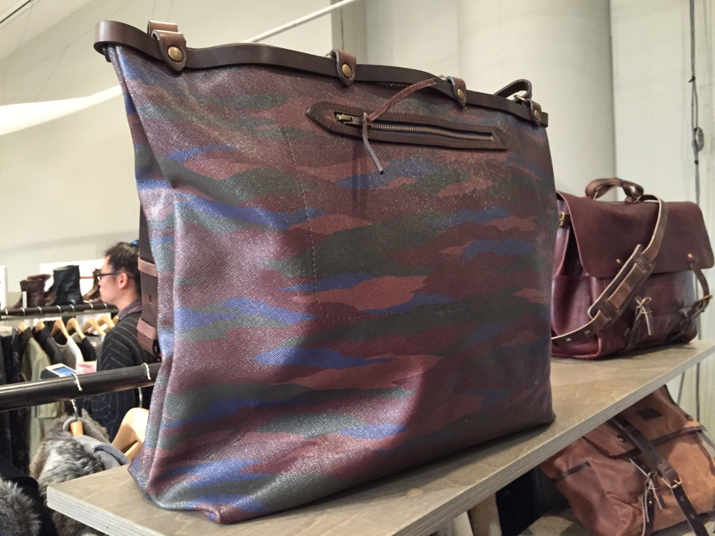 Bleu de Chauffe's camouflage take on a reporter's bag made in an LV style fabric